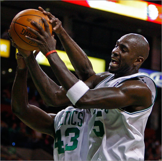 Celtics Kendrick Perkins (left) and Kevin Garnett (right) teamed up for a first half rebound.
