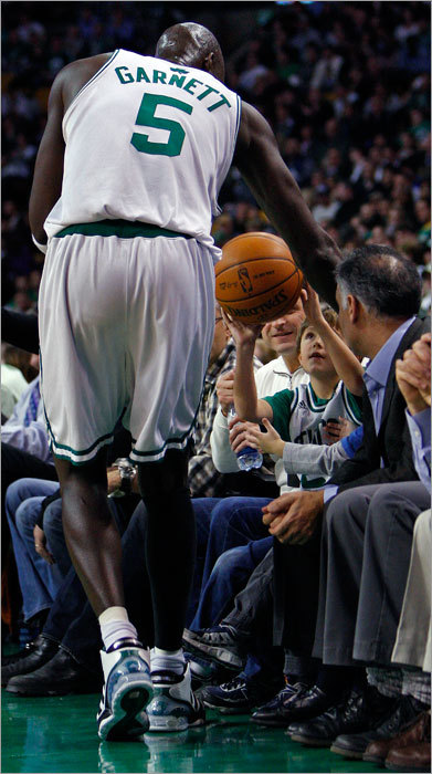 A young front-row fan returned the ball to Kevin Garnett after an errant pass in the second quarter.