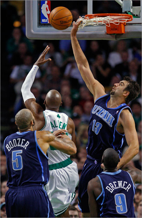 Utah's Mehmet Okur got all net, but no ball as he tried to stop Ray Allen's shot in the first half.