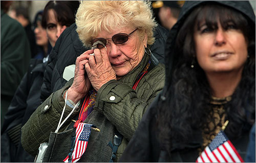 Some viewers of the Veterans Day Parade in Boston had strong emotional attachments. Frances Kilday, left, of Jamaica Plain wiped tears from her eyes during her annual viewing as she watched from Tremont Street. Her brother was a Korean War veteran. Patty Arellano, right, of Boston has a friend who is a Vietnam veteran.