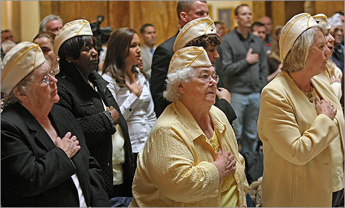 Women veterans recited the Pledge of Allegiance during Veterans Day ceremonies at the State House.