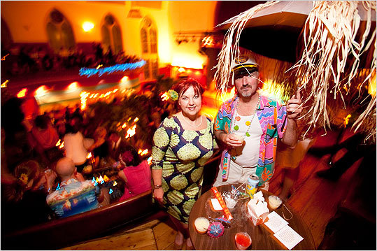 From left, Johnna Barry of South Boston and Brady Davenport of Roslindale stood under Davenport's 'portable tiki hut' during the party.
