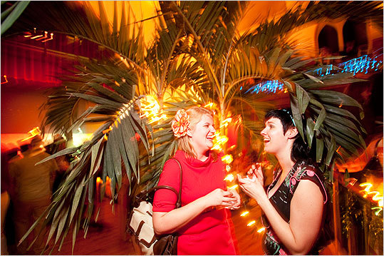 From left, Gretchen Eisenman and Alexis Weglowski, both of Somerville, enjoyed fruity cocktails under a palm tree. 'I love this tree,' Weglowski said. 'We've had a very long week and it is important to feel like we're on a tropical getaway as much as possible.'