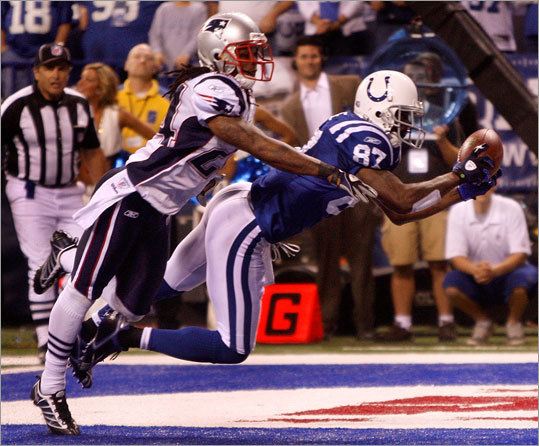 Colts receiver Reggie Wayne (87) mades the game winning touchdown catch late in the fourth quarter. Cornerback Jonathan Wilhite tried to stop him but couldn't.