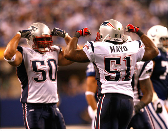 Patriots linebackers Rob Ninkovich (50) and Jerod Mayo (51) celebrated a sack in the second quarter.
