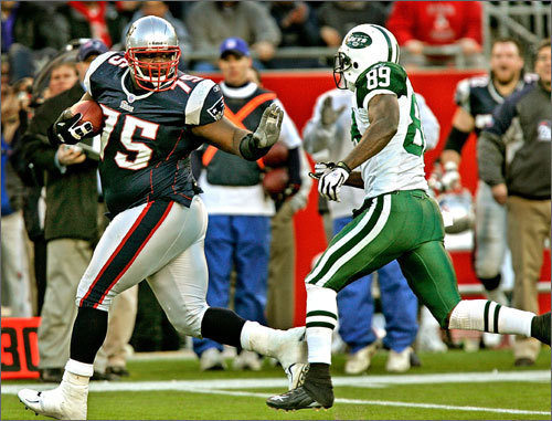 2007 AFC Wild Card: New England 37, NY Jets 16 The New York-Boston playoff football rivalry has ramped up recently. The Patriots finished the 2006 season with a 12-4 record, winning the AFC East. The Jets finished 10-6, which got them the wild card bid. Coincidentally enough the teams squared off in the wild-card matchup. The Pats poured it on from start to finish, going up by 10 at halftime before adding 20 points to the Jets' 6 in the second. Quarterback Tom Brady was flawless, throwing for 212 yards and 2 scores. Here, Vince Wilfork threw a stiff arm as he returned a Chad Pennington fumble.