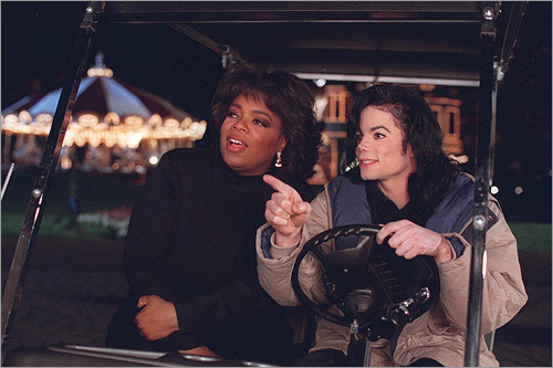 Opray Winfrey and Michael Jackson in a golf cart