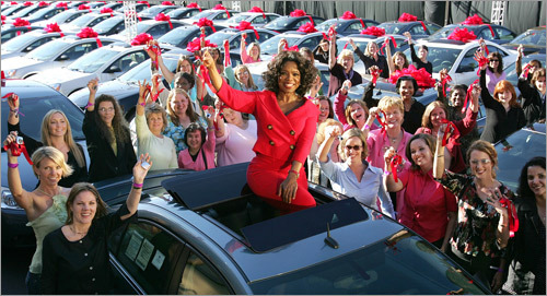 Opray Winfrey gives away cars for free