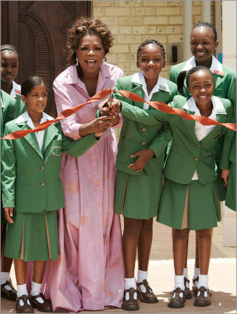 Oprah Winfrey cuts the ribbon at African school