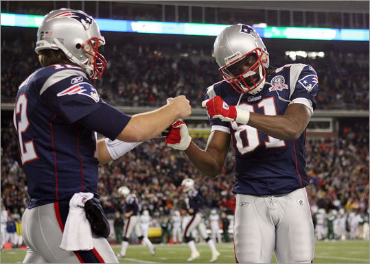 Randy Moss and Tom Brady celebrated Laurence Maroney's touchdown in the second quarter.