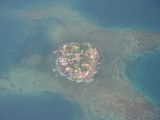 This is a photo of a small village among coral in Kuna-Yala, Panama. Kuna-Yala is a collection of villages similar to this in an archipelago in the Caribbean. The area is facing extinction because of rising sea levels.