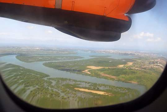 Approaching the Kenya coast, with the island city of Mombasa in the right background.