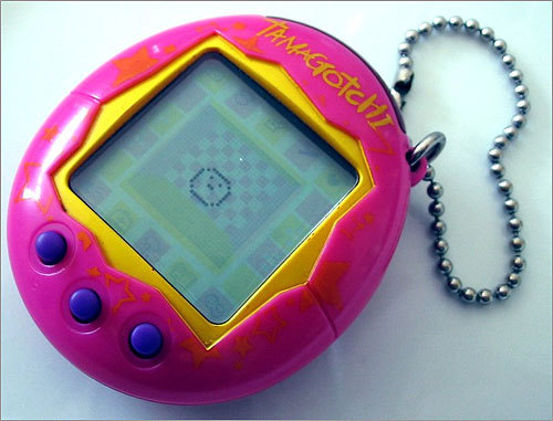 1996: Tamagotchi The first virtual pet was an egg-shaped key chain with a small LCD screen on which the pet's life was lived out. Some called it an annoying fad, and some schools banned kids from using them during class. Tamagotchi did, however, lead to an evolution of virtual pets that took on furrier characteristics and eventually found homes on the Internet.