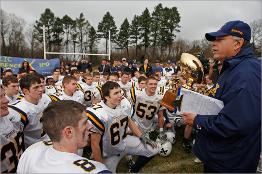 Xaverian Brothers High School's head coach Charlie Stevenson hheld the winners trophy after defeating St. John's Prep 21-16 at Cronin Memorial Field.