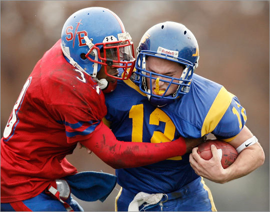 East Boston's Brandon Amodeo (12) tried to break free of South Boston running back Daquan Hill