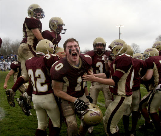 Concord-Carlisle football players celebrated after beating Bedford Thanksgiving Day.