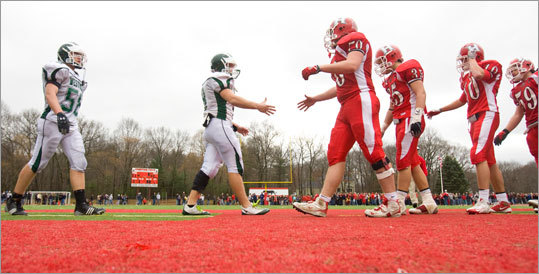 Holliston players shook hands with their Westwood rival after winning the two teams' Thanksgiving Day game.