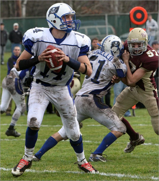 Bedford High School quarterback Kevin Cangiano (14) gets plenty of protection during Thanksgiving Day football game against Concord-Carlisle in Concord.