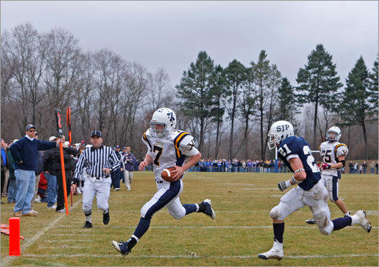 Xaverian's quarterback Alex Phelan beat St. John's Prep Mike Uva to the end zone for a rushing touchdown during fourth-quarter action Thanksgiving Day.