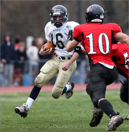 Needham High School quarterback Kevin Brennan (16) scrambled along the sideline against Wellesley.