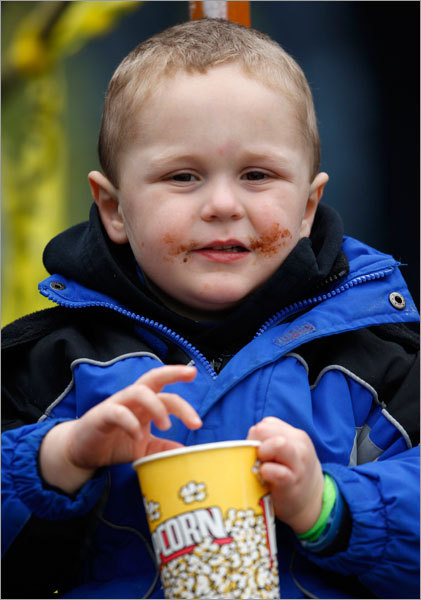 St. John's Prep fan, Caleb Gerakaris, 3, of Danvers enjoyed some popcorn during the team's game with Xaverian Thanksgiving.