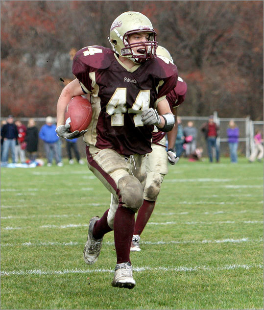 Concord-Carlisle's Max Barrett (44) took off with an interception en route to a score, putting his team up 24-0 against Bedford in their Thanksgiving Day game.