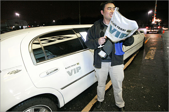 Best Buy VIP contest winner Chi Nguyen steps out of a limo at the Best Buy in Dedham on the morning of Black Friday.