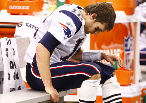 Tom Brady sat with his head down in the fourth quarter as the Saints wrapped up a victory over the Patriots.