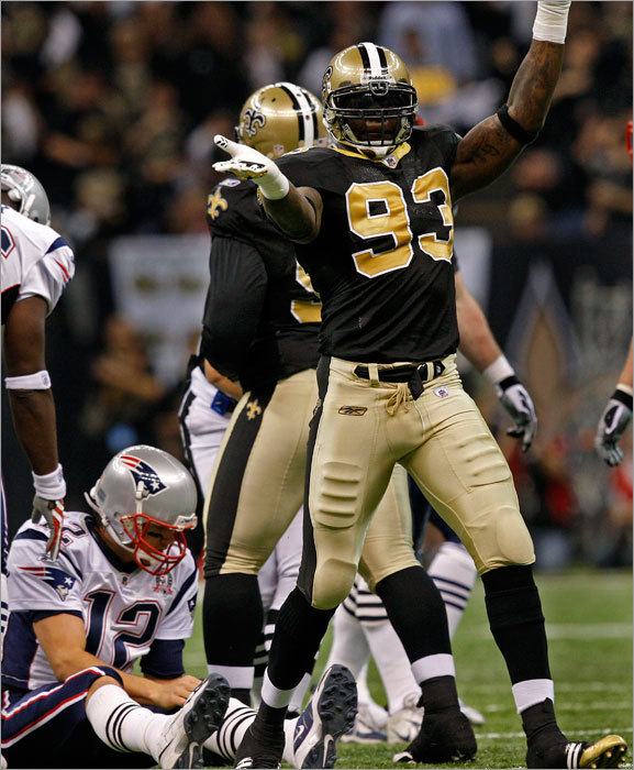Saints' Bobby McCray (93) celebrated after he sacked Patriots quarterback Tom Brady in the second quarter.