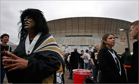 A New Orleans fan dressed in serious Saints color partied before the game outside the Superdome.