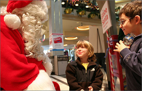 Nov. 29 in Cambridge Luciano Cincotti (left) tells Globe Santa what he wants for Christmas as brother Giacomo Cincotti stands patiently nearby at the CambridgeSide Galleria. Learn more Make a donation