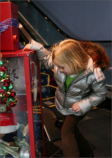 Nov. 28 in Dedham Murphy watches her bill float to the bottom of the donation container. Learn more Make a donation