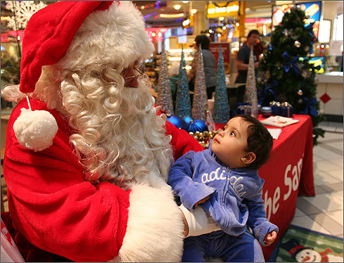 Nov. 29 in Cambridge Noha Boulfkit stares at Globe Santa during a shopping trip with mom at CambridgeSide Galleria. Learn more Make a donation
