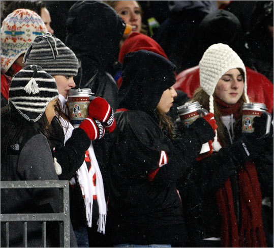 Reading fans kept warm with hot drinks.