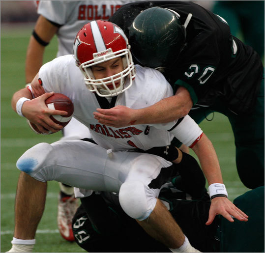 Holliston quarterback Sean Mayo was brought down by Austin Prep's Matt Mulcahy.