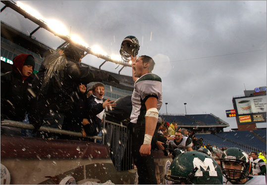 Marshfield's Sean Griffith celebrated with his team's fans in the stands after a Super Bowl victory over Masconomet.