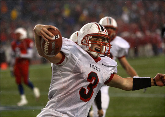 Reading's Ryan Pollock celebrated after his third quarter touchdown put the Rockets up by two touchdowns over Natick.