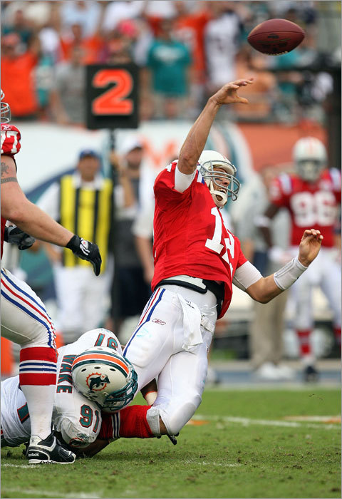 Tom Brady's last pass attempt of the game was intercepted, sealing a 22-21 victory for Cameron Wake (91) and the Dolphins on Sunday at Land Shark Stadium in Miami.
