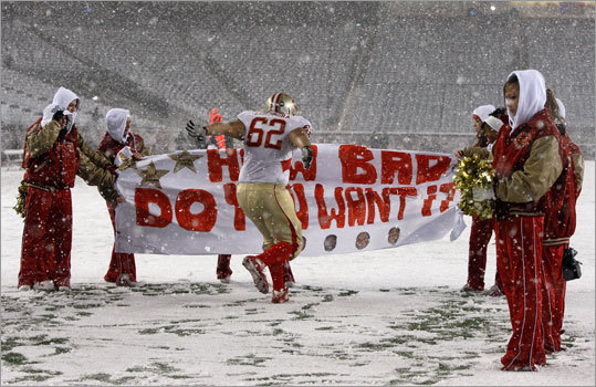 Everett's Jainyme DaSilveira got to break the banner as his team took the field in the second half.