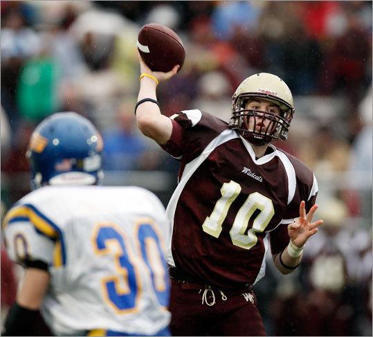 Whittier quarterback Dillon Ryan passed over an East Boston defender.