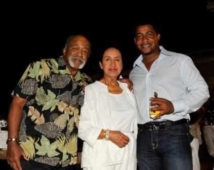 Luis and Maria Tiant posed with George Bell.