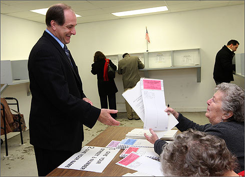 Election day is here, and the Senate candidates are heading to the polls. Click through this gallery to see the candidates casting ballots -- presumably for themselves -- and other photos from voting places today. Democratic Representative Mike Capuano smiled as he took his ballot from a poll worker at the Department of Public Works in Somerville shortly after 7 a.m.