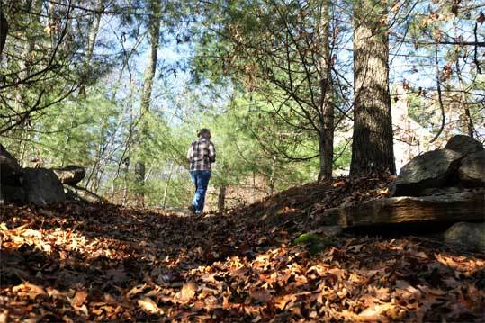 Amateur historian Gail Clifford explores the woods near the site of the Hopkinton Springs resort, an early 19th-century span that once stood near Spring Street and Lyford Road.