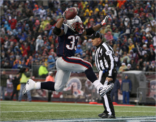 The Patriots' Kevin Faulk celebrated after scoring a 3-yard rushing touchdown in the second quarter against the Carolina Panthers. The score and ensuing extra point tied the game, 7-7.