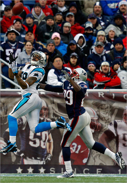 The Carolina Panthers' Steve Smith (left) caught a 41-yard touchdown pass in the first quarter over the Patriots' Shawn Springs. The Panthers went up 7-0 after the ensuing extra point.
