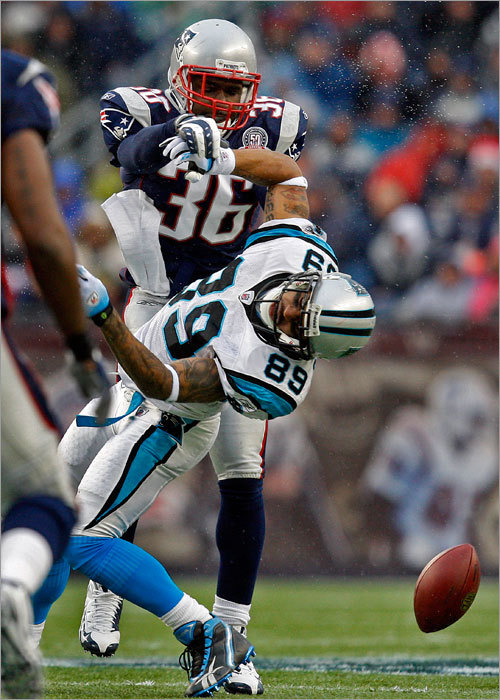 Water was flying as the Patriots' James Sanders hit Panthers WR Steve Smith, ensuring a first-half incompletion.