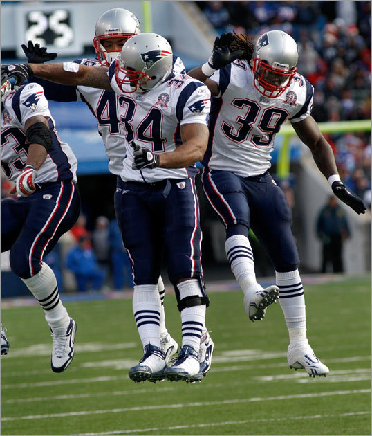 The Patriots celebrated following Maroney's (right) touchdown.