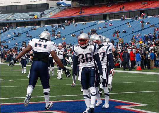 Patriots players took the field in Orchard Park, N.Y. before the game. Unlike Foxborough, which was hit by about a foot of snow, there was no storm in upstate New York Sunday.