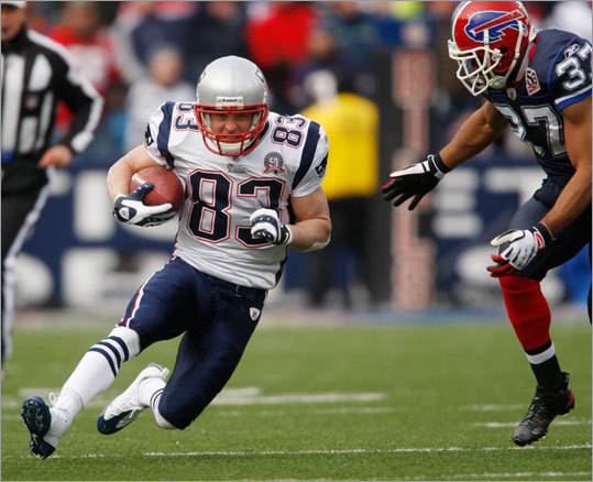 The Patriots' Wes Welker took a reverse against Buffalo Bills defender George Wilson (37) in the first quarter.