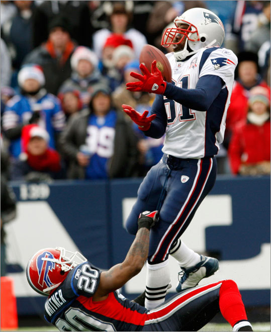 Buffalo's Donte Whitner (20) interfered with a pass intended for Randy Moss during the first half. The Bills were penalized on the play.